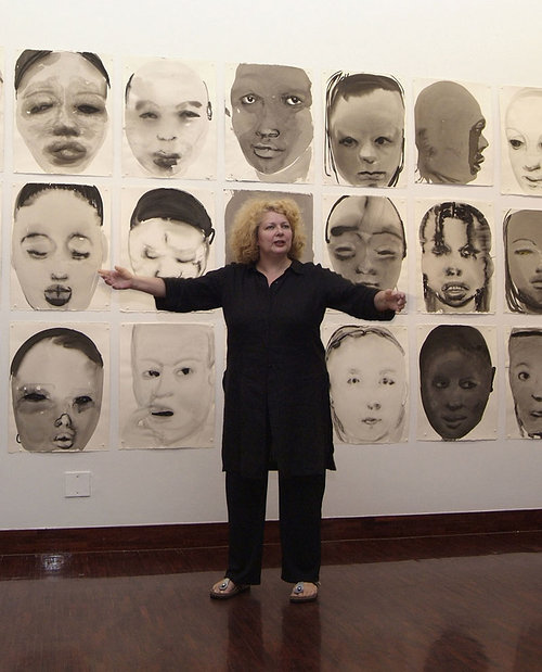 Marlene Dumas stands in front of her artwork