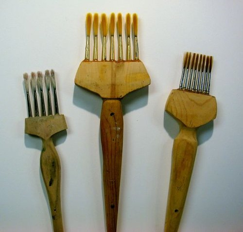 Brush with multiple brushes attached to it