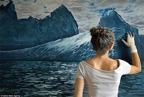 artist creates finger painting of icebergs