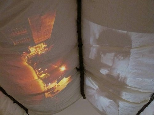 A projection onto a cotton roof of a tent-like structure