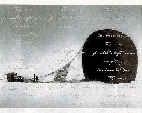 A printed image of two people standing in front of a hot-air balloon, overlaid with cursive text