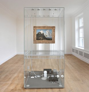 A photograph of a permanent installation featuring a classical painting encased in plexiglass