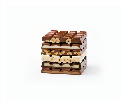 A photograph of a stack of chocolate bars each of a different flavour