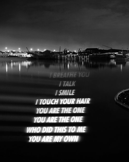 A photo of a poem projected onto a body of water
