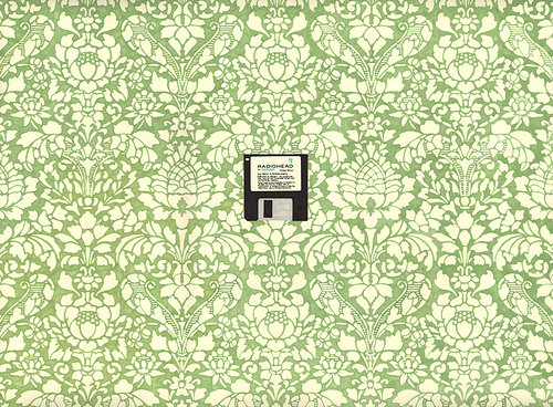 A drawing of a floppy disk on a background of floral wallpaper