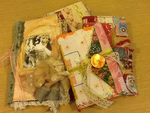 A stack of journals made from scrap fabrics and paper