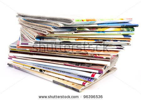 A stack of magazines on a white background