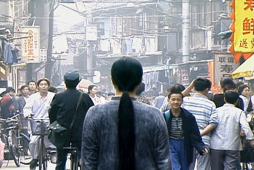"A still from Kimsooja's ""Needle Woman"""