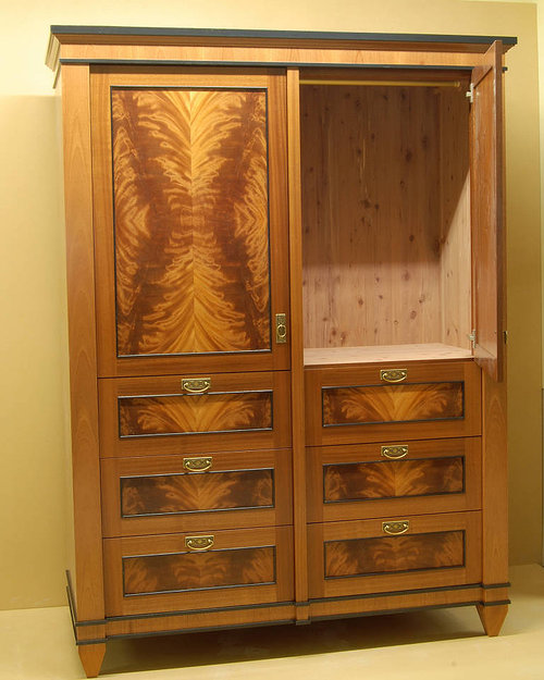 A large, handmade wardrobe with wood detailing