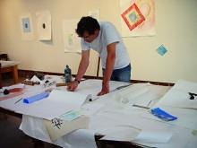 An image of Richard Tuttle creating some works on paper
