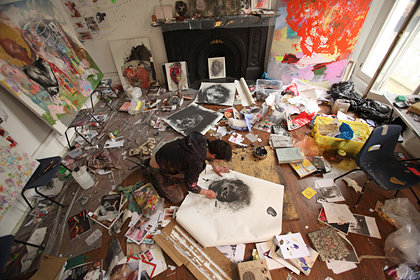 A photo of Antony Micallef working on the floor in his studio