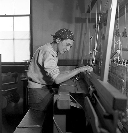 Anni Albers weaving on a loom in her studio in Black Mountain College