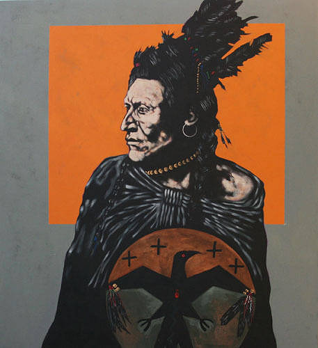"A portrait of an aboriginal ""medicine man"" holding a painted drum"