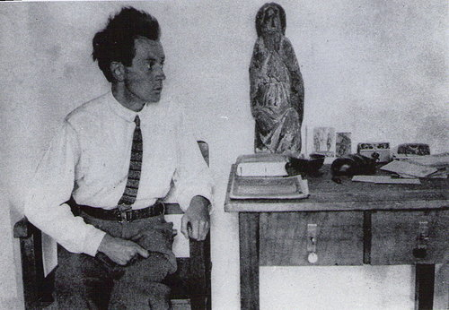 A black and white photograph of Egon Scheile seated in his studio