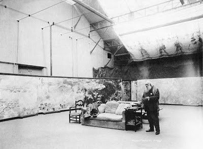 A photograph of Claude Monet at work in his home studio in France