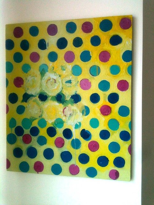 An abstract painting with a background of multi-coloured polka dots