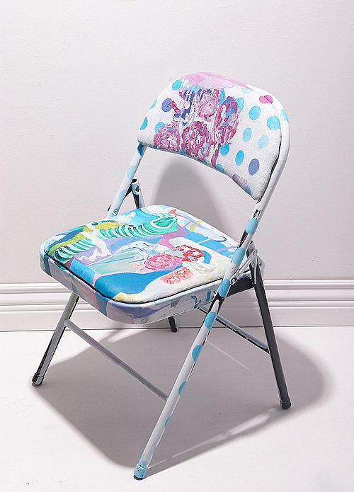 A studio chair painted all over with abstracted designs.