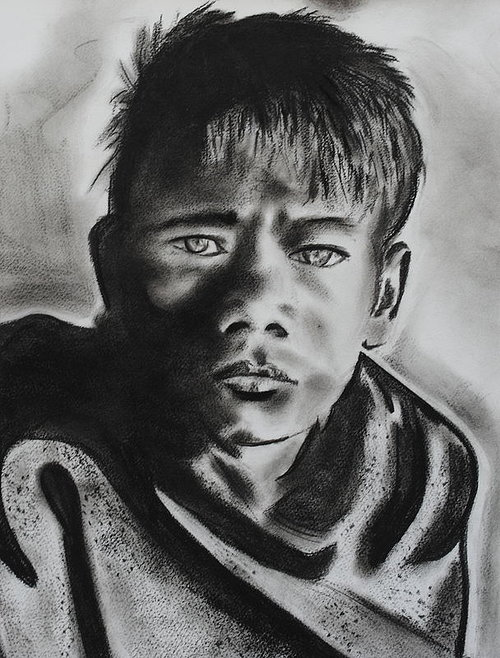 A charcoal drawing of a young Afghan boy