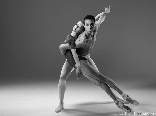 A black and white photo of two dancers in a ballet pose