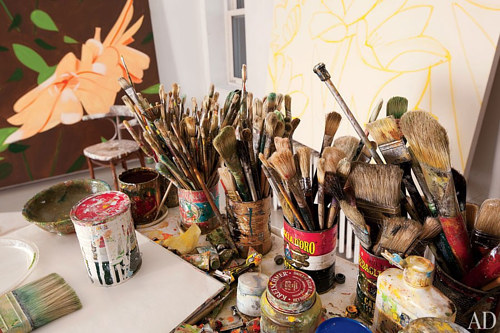 A photo of cans filled with brushes in Alex Katz's studio