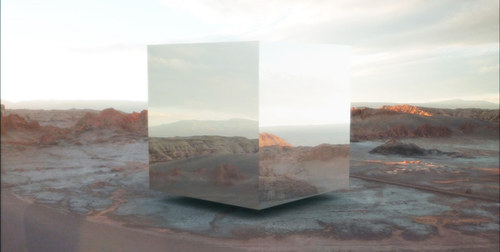A digital image of a mirrored cube floating above a desert