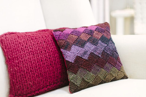 Two hand made knitted pillow cases