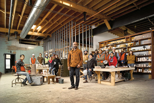 A photo of Theaster Gates with employees and assistants in his pottery studio