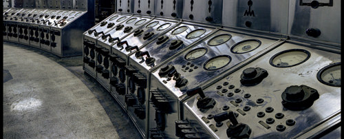 A photo of an old power plant control room