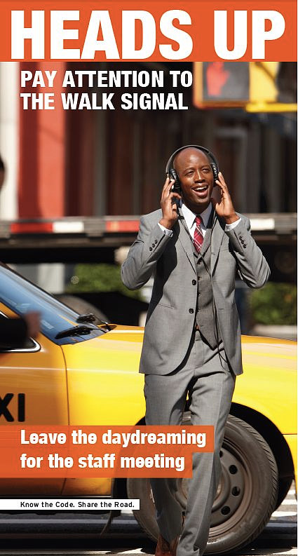 An advertisement featuring a smartly-dressed man crossing the street with headphones on