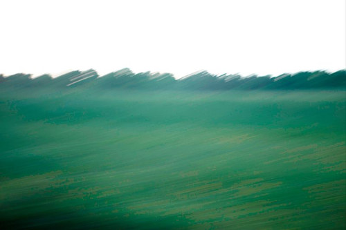 An abstracted photograph of the view from the window of a moving car