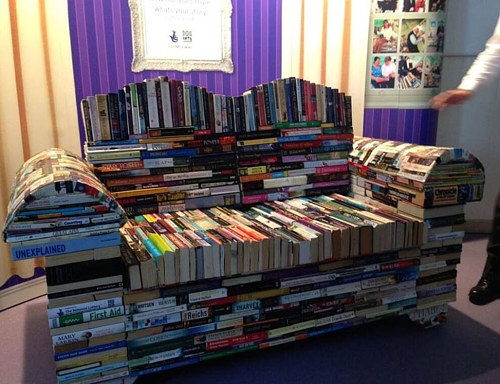 A sofa made entirely from books adhered to each other