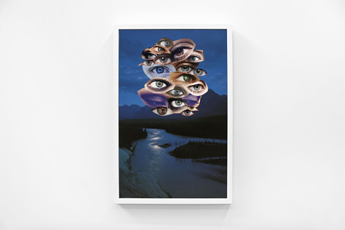 A collage of a cluster of eyes over a dark nighttime landscape