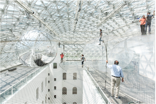 An installation featuring nets strong enough to support human weight, high above the ground