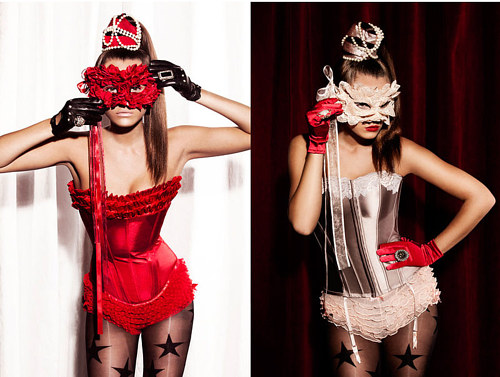 A promotional photograph with two models wearing masquerade masks