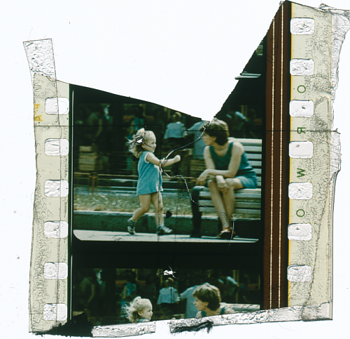 A fragment of a found film reel, with an image of a young girl playing