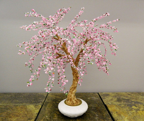 A French-beaded sculpture of a cherry tree in bloom