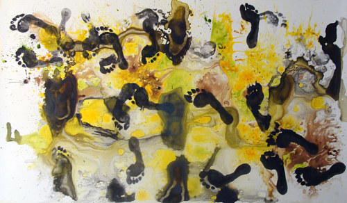 A yellow and black ink painting with scattered footprints