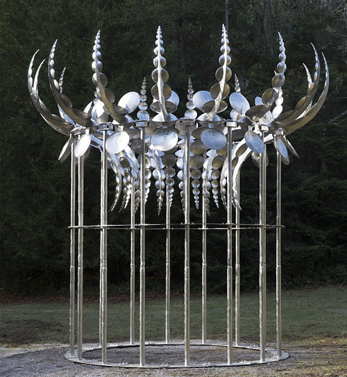 A kinetic sculpture composed of many plates of stainless steel