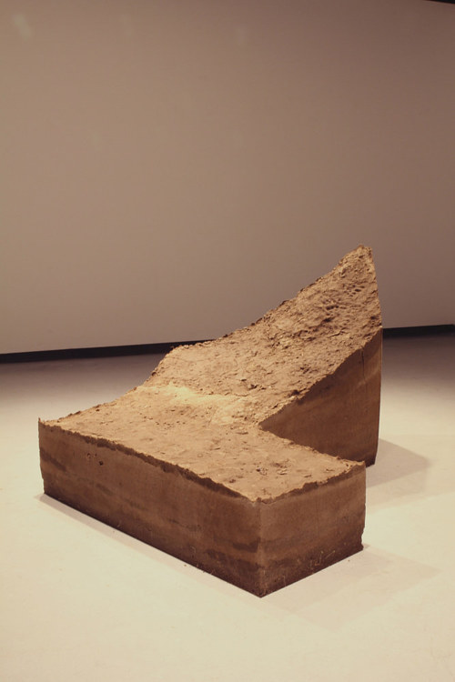 An L-shaped sculpture consisting of compacted dirt