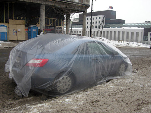 A photo of a car wrapped in plastic in Montreal
