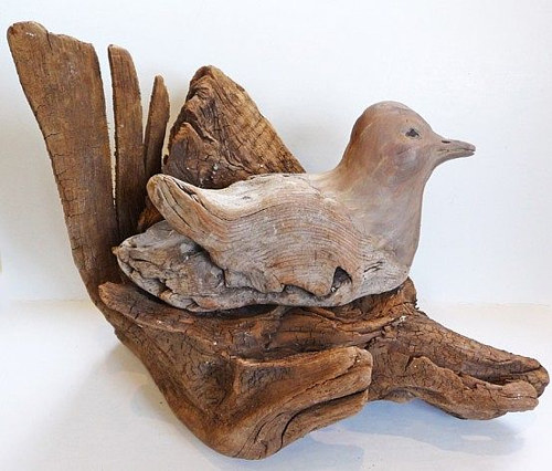 A driftwood sculpture of a sitting bird