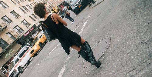 A photo of a woman walking in New York City