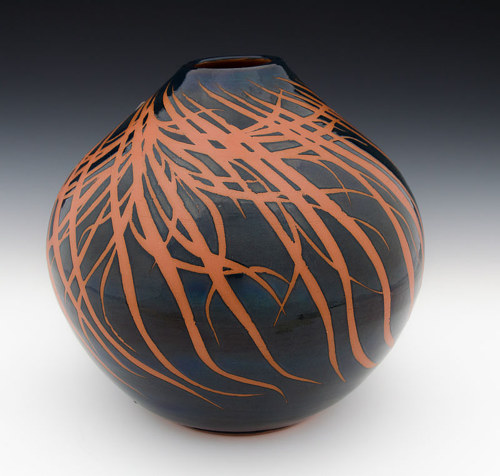 A black handmade ceramic vase with red detailing