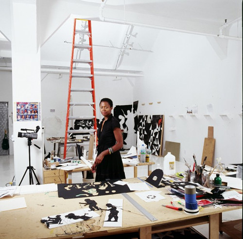 A photo of Kara Walker working in the studio