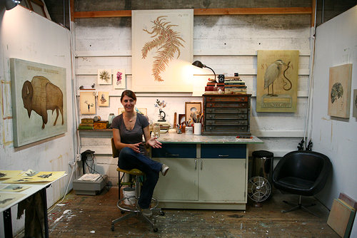 Alison Kendall sitting on a chair in her art studio