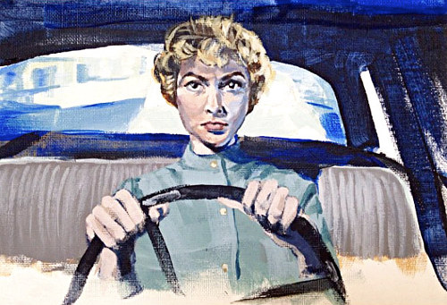A portrait of a woman at the wheel of an old car