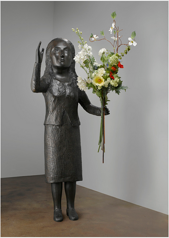 A sculpture of a woman holding a bouquet of flowers