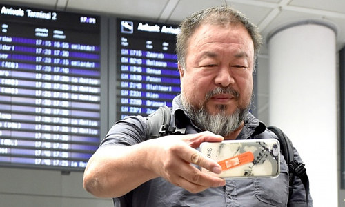 A photo of Ai Weiwei taking a photo of himself at an airport