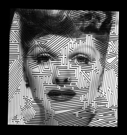 A print of Katherine Hepburn's face covered in zigzagging lines