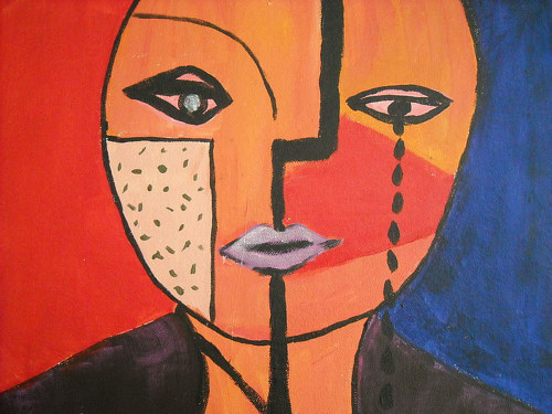 A painting of a cubist face with tears running down one side of its face